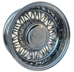 Trueclassic Wire Wheel is shown with unique Trueclassic Center Cap and Medallion. Wheel shown is a 14 X 7 inch reverse type.