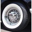 Chrysler wire wheel shown for demonstration purposes only with a wide whitewall tire. BFGoodrich P225/75R15. Wheel and tire packages are available at extra cost.